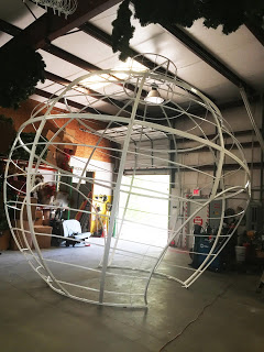 steel frame under construction for creating large walk-through christmas ornament